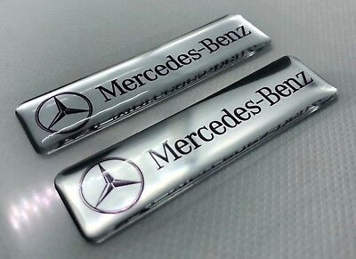 2x Mercedes-Benz Silver Logo 3D Domed Stickers. Size 65x17mm.