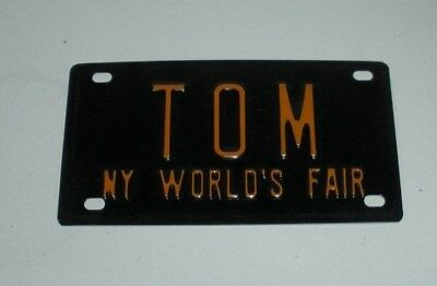 "1964 New York World's Fair, ""TOM""  Miniature Tin License Plate"