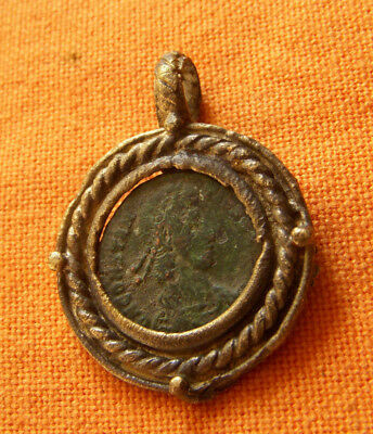 A71. Roman style bronze pendant with authentic Roman coin