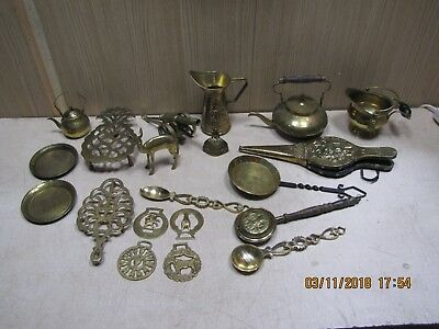 selection of vintage brass ornaments for display ornaments