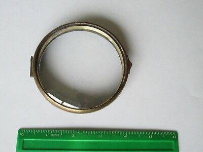 Hinged metal clock bezel with convex glass.