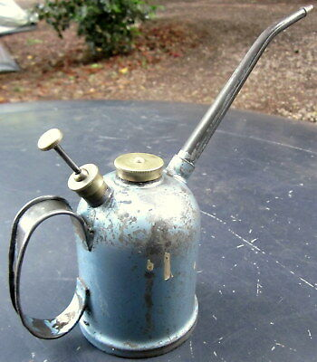 collectors vintage REGA 1/2 pint , thumb operated oil can .