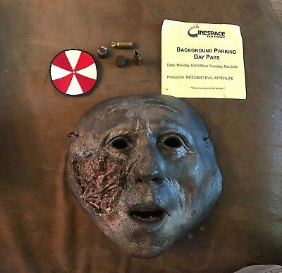 """Resident Evil """"Afterlife"""" zombie mask, Milla's Ear plugs ,patch ,parking pass +"""