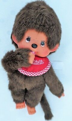 Vintage Monchichi Thumb Sucker Monkey Troll Anime Collectible with a red Bibb