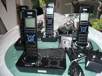 Set of 4 iDECT cordless phones with docking stations and answer machine.