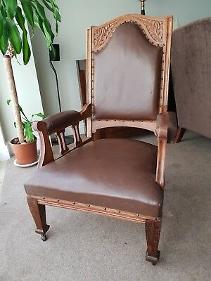 Pair of Antique carved Wood Leather Chairs on wheels Victorian