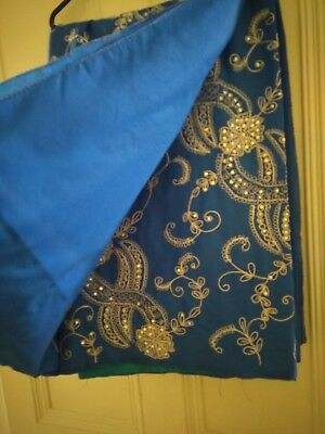 Blue sari with silver sequins. Fall sewn in.