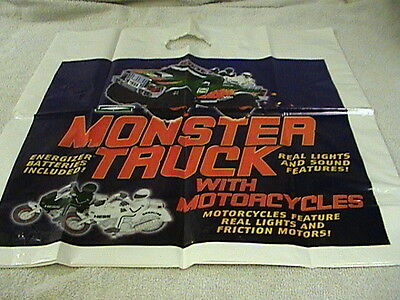 2007 HESS MONSTER TRUCK WITH MOTORCYCLES...NEW  and NEW BAG ! (batteries remove)