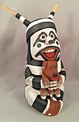 Hopi Clown holding His dog By Neil David, Jr.