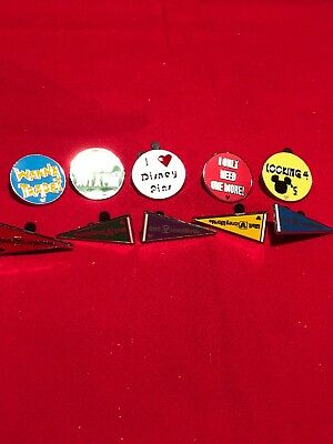 10 Disney pins  5 Pin Trading Phrases & Set of 5 Pennants  As Shown lot X