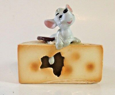 vintage porcelain mouse figurine on cheese, so cute!