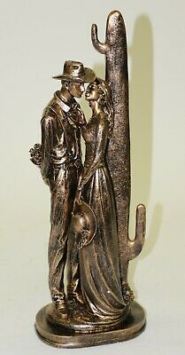 Large sculpture of a Western cowboy with a Flower Presenting to his Girl Bronze