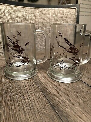 Two (2) 1982 Avon Flying Geese Beer Stein Mug Clear Glass,