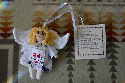 Keepsake tooth fairy doll  and saying.   New never used