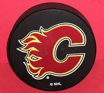 Calgary Flames NHL Official Licensed Ravens Athletic Team Hockey Puck