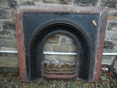wide large antique cast iron fireplace arch insert fire surround insert altered?