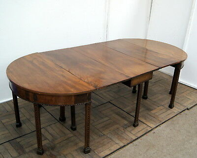 A very rare and unusual model of a George 111 mahogany D end gateleg dining tabl