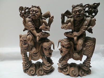 Rare Chinese Hand-carved Wooden Warriors on Elephants Mirrored Pair c1880s?