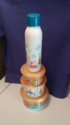 tupperware 3 pc christmas canister set and a 25 oz water bottle