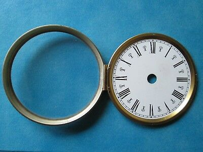 Hinged metal clock bezel with dial and convex glass.