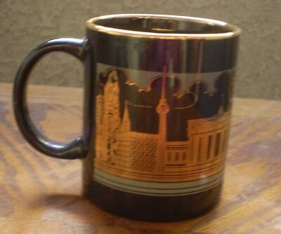 A Black And Gold Coffee Cup With Berlin Germany On It !