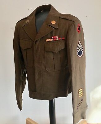 WWII 43rd Infantry division artillery ike jacket. Unique insignia