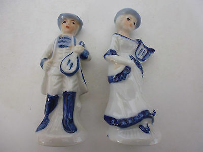 Pair of Pottery figurines a Lady and a man musician blue and white