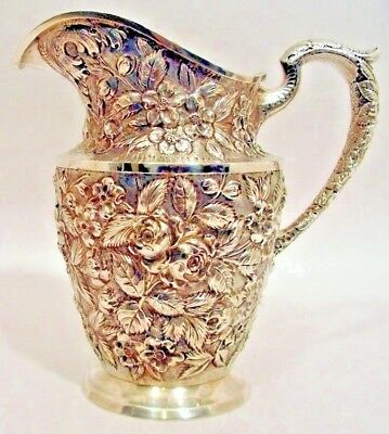A repousse sterling water pitcher, Baltimore Rose, Schofield Co., Baltimore.