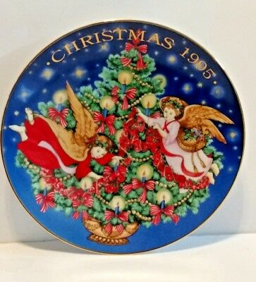 1995 Avon Collectible Trimming the Tree Christmas Plate
