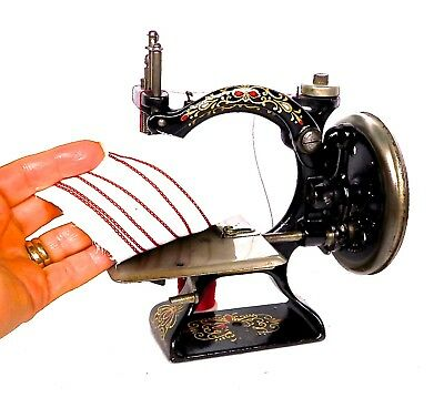 Antique  Hand Crank Toy Sewing Machine * * F & W Automatic * * Sews Perfect.