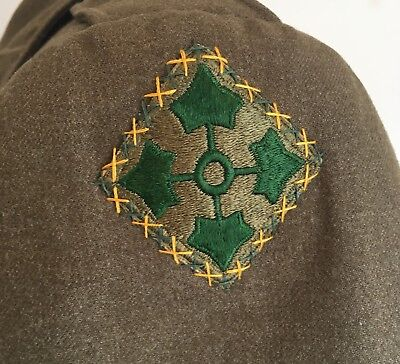 WWII 4th infantry military police ike jacket.  Excellent cross stitching. Named