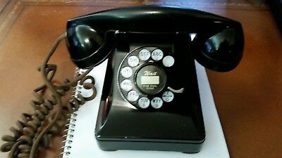 1937 western electric 302 telephone, first year, short ears, small buttons.