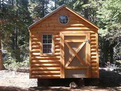 1 acre of land with cabin, garage and trailer