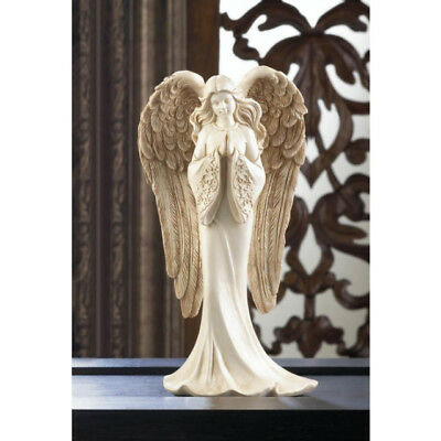 Praying Angel Figurine flowing gown  has fantastically large and detailed wings