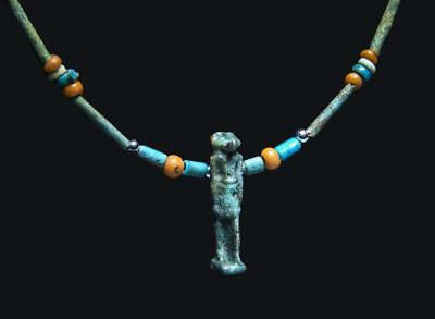 Egyptian necklace with faience beads & amulet of god Khnum: 1st millenium BC.