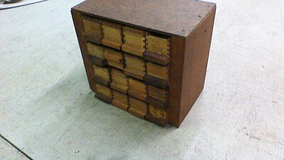 Vintage 16 Wooden Joint Slide Top Boxes in a hand made cabinet.
