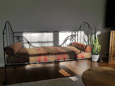 Original 1900s antique cast wrought iron cot or day bed - dismantles fabric old