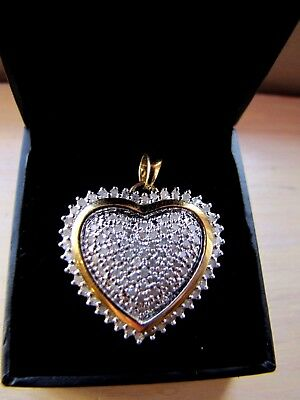 14 K gold over sterling silver large heart pendant with real diamonds!