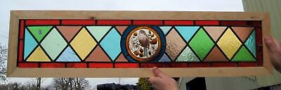 A Vibrant Antique Stained Glass Painted Bird Window