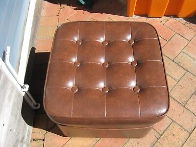 VINTAGE  RETRO BROWN BUTTON BACKED 1980s FOOT STOOL ON 4 CASTORS .