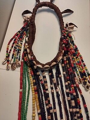 Old African Headdress with Cowrie shells, iron leaves, mixed beads