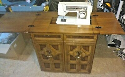Vintage 6110 Singer Sewing Machine With Foot Pedal in Cabinet Many Attachment
