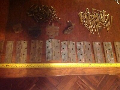 architectural salvage brass fittings, screws, hinges and door guides.