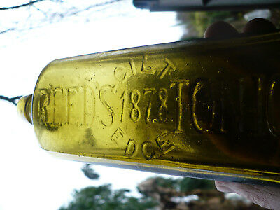 Unusual yellow green color REEDS GILT EDGE TONIC  1878  applied top