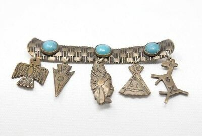 Antique Turquoise Indian Pin with free hanging charms, pin clasp on back. EUC