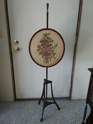 Antique early 19th century fireplace screen with silk needle point.