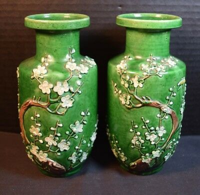 Pair of Chinese Green Porcelain Vases With Embossed Flowers