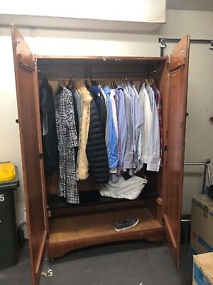 1950s wardrobe with rail and shelves solid timber unsure of what type .