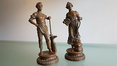 2 Spelter French Figures Of A Blacksmith And Industry Lady With Some Dammage.