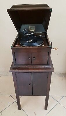 Antique His Masters Voice Gramophone and Cabinet with many records.